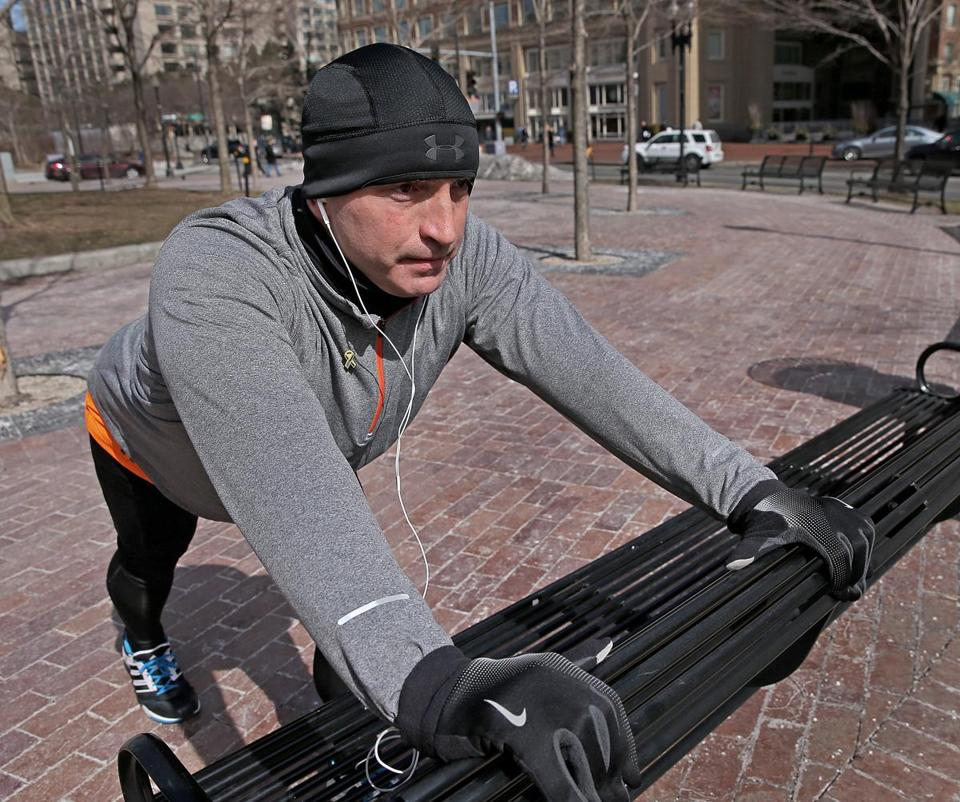 Peter Riddle stretched for a run along the Rose Fitzgerald Kennedy Greenway. He helped rescue a victim who lost a leg in the Boston Marathon bombings last year and struggles with post-traumatic stress disorder.